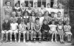 1950 - Wheat Ridge School - First Grade. Back row, left to right: Teacher Miss Dye, Unknown, Unknown, Unknown, Unknown,