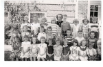 1950 - Wheat Ridge Grade 1.     Back row left to right: Larry Schreiber, Pete Wilcox, Linda Lamb, Flora Musselman, Mrs.