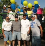 Carnation Festival Parade. In front, left to right: Al Capra, Dale Andersson, Doug Greenburg and Mike Furness. On traile